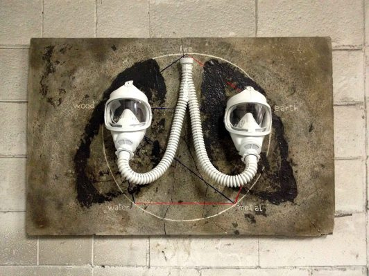 109x70.5 cm. Wood canvas, cement, tar, acrylic paint, gas masks