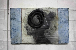 80x110 cm. Wood canvas, cement, nails, iron metal, copper, brass, tar, acrylic and oil paint